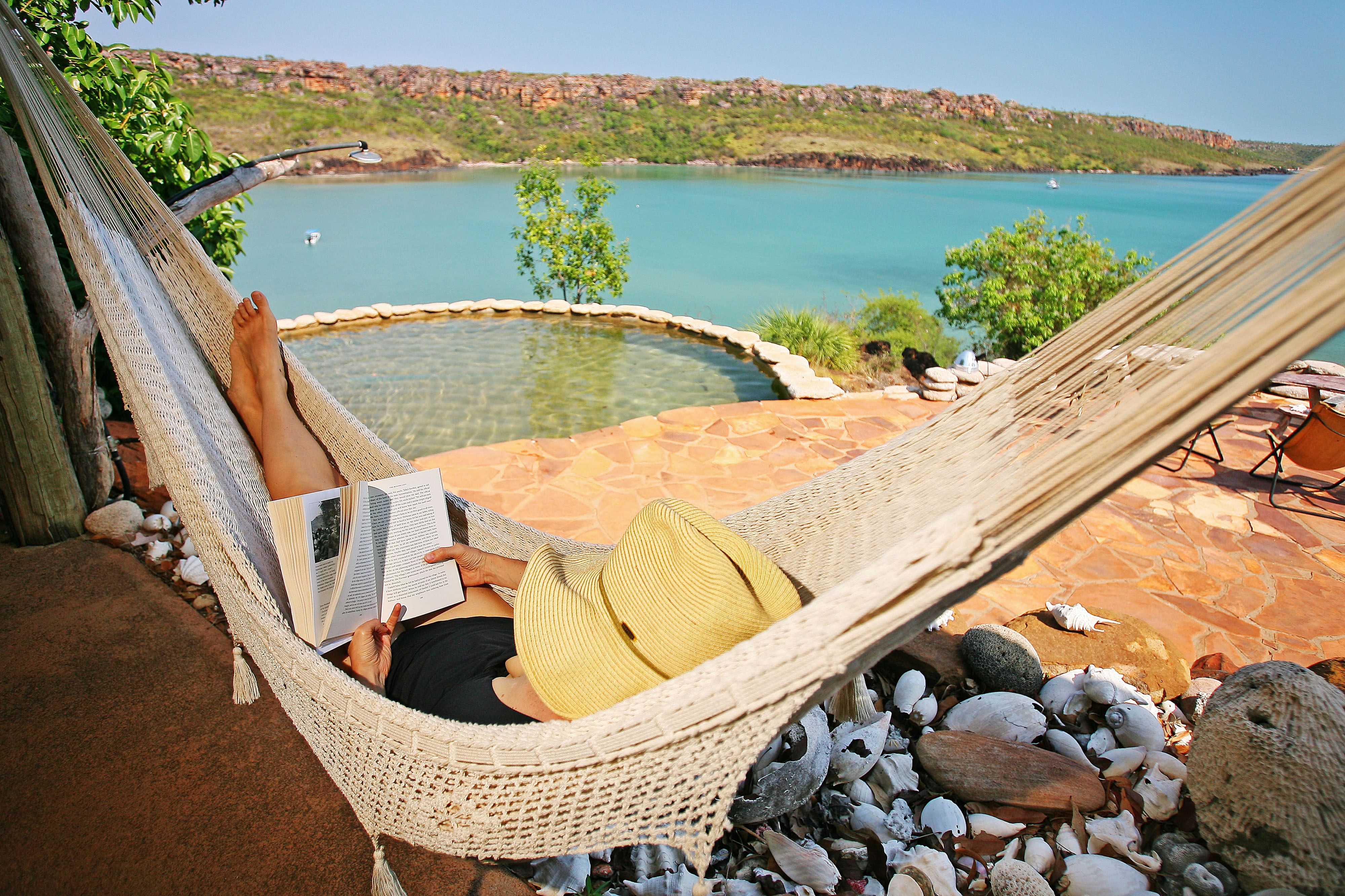 A guest relaxes at Faraway Bay's Eagle Lodge. Picture: Nathan Dyer.